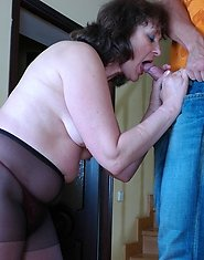 Heated mom in black control top hose seducing a serviceman into nylon sex